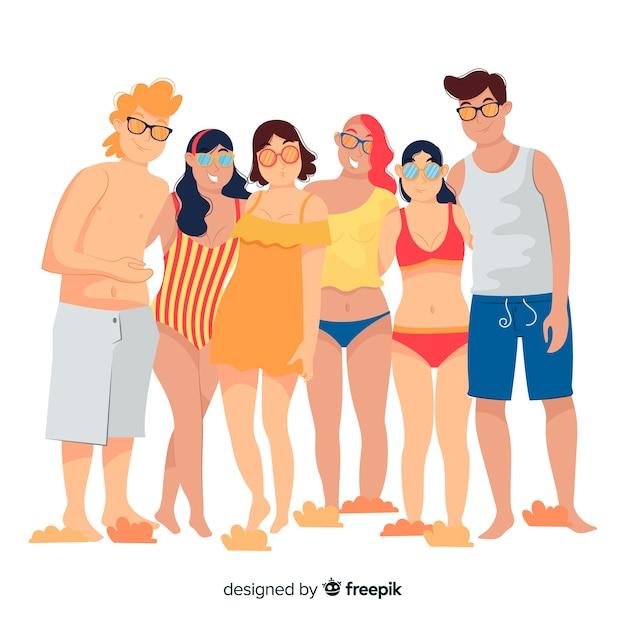 Gruppe junge leute, die für ein foto aufwerfen Kostenlosen Vektoren