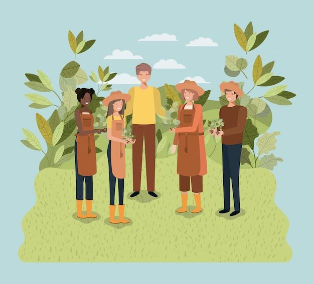 Gruppe von menschen, die bäume im park pflanzen Premium Vektoren