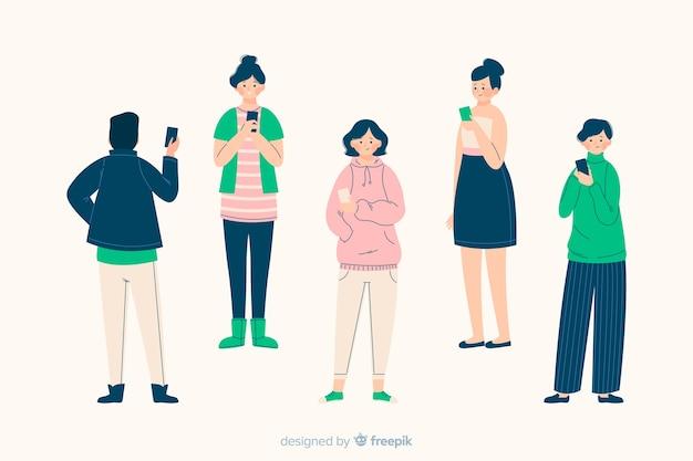 Gruppe von personen, welche die smartphones zusammen veranschaulicht betrachtet Kostenlosen Vektoren