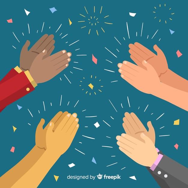 Hände, die mit konfettihintergrund applaudieren Kostenlosen Vektoren