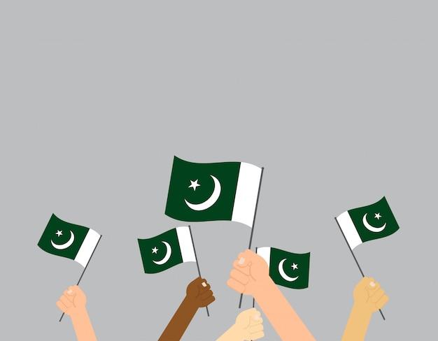 Hände, die pakistan-flagge halten Premium Vektoren