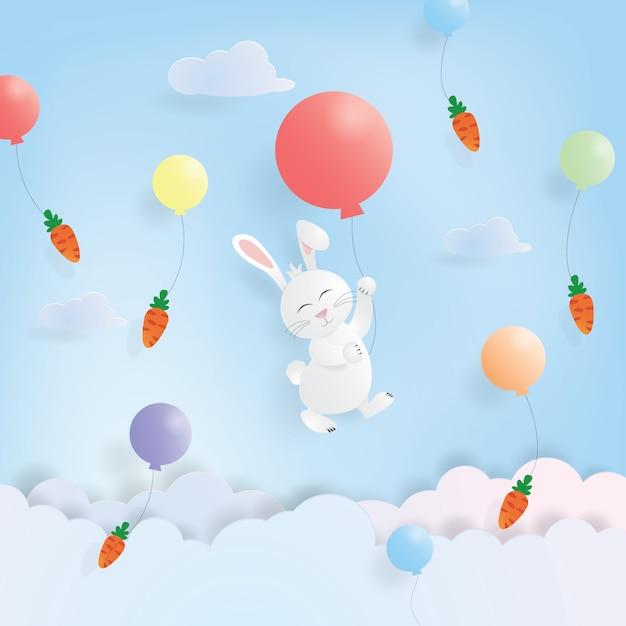Hängendes kaninchen und karotte ostern-tagesmit buntem ballon im papierschnitt Premium Vektoren