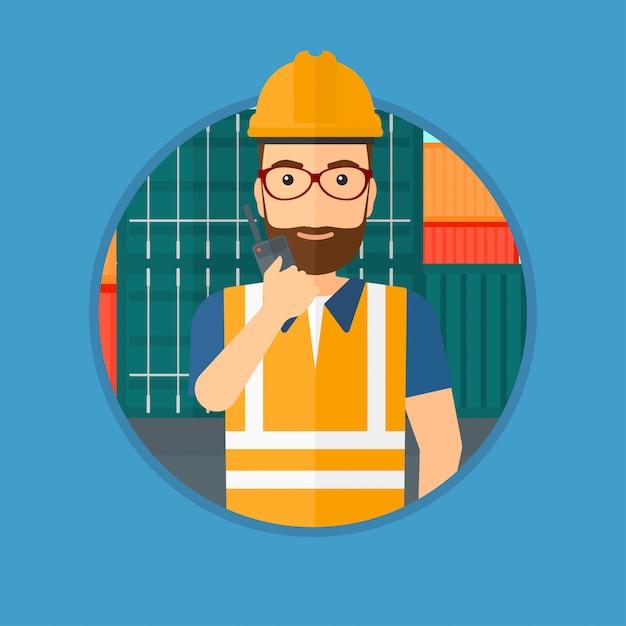 Hafenarbeiter, der auf drahtlosem radio spricht. Premium Vektoren