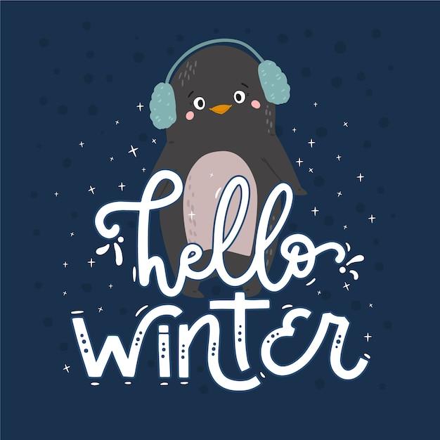 Hallo winter schriftzug mit pinguin Kostenlosen Vektoren