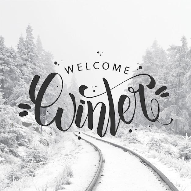 Hallo winterkonzept schriftzug Kostenlosen Vektoren