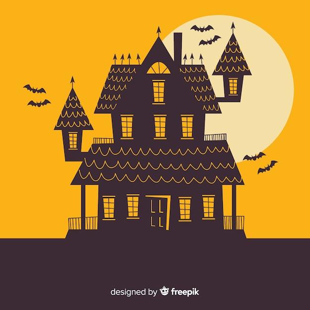 Halloween-geisterhaus mit flachem design Kostenlosen Vektoren