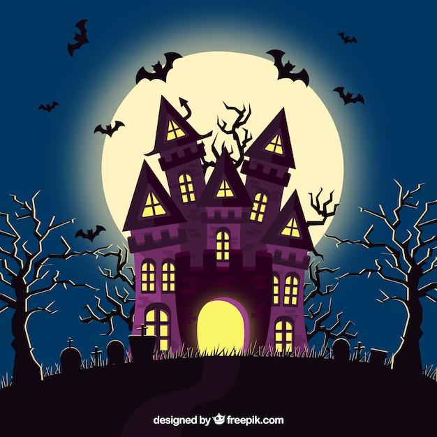 Halloween haus mit fledermäusen und friedhof Premium Vektoren