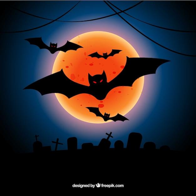Halloween hintergrund mit orange mond und fledermäuse Kostenlosen Vektoren