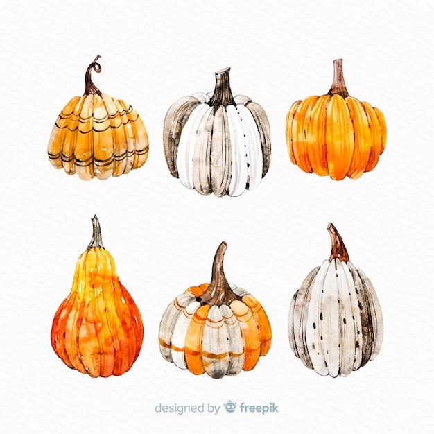 Halloween kürbisse in orangetönen Kostenlosen Vektoren