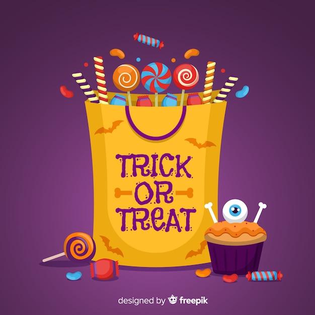 Halloween-süßigkeitstaschenhintergrund Kostenlosen Vektoren