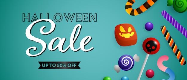 Halloween-verkaufsbeschriftung mit netten süßigkeiten und bonbons Kostenlosen Vektoren
