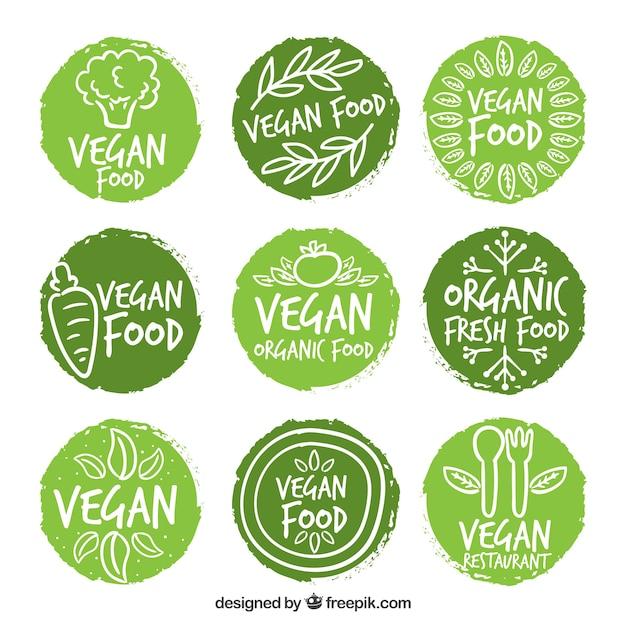 Hand bemalt gerundet vegan lebensmittel-etiketten Premium Vektoren
