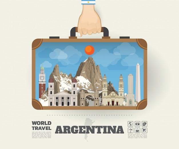 Hand, die argentinien-markstein-globale reise und reise infographic-tasche trägt Premium Vektoren