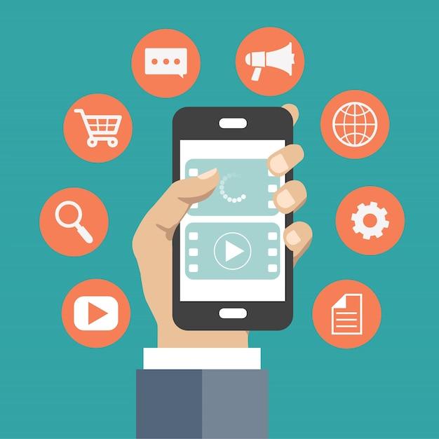 Hand, die das telefon mit ikonen um es hält Kostenlosen Vektoren
