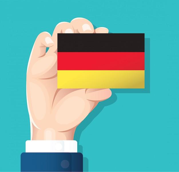Hand, die deutschland-flaggenkarte hält Premium Vektoren