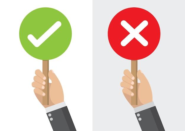 Hand, die ein schild rechts und falsch für rückgespräch hält Premium Vektoren