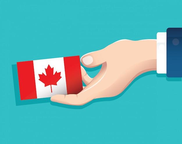 Hand, die kanada-flaggenkarte hält Premium Vektoren