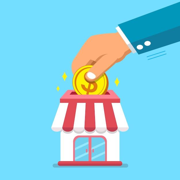Hand, die münze in geschäftsspeicher einsetzt Premium Vektoren