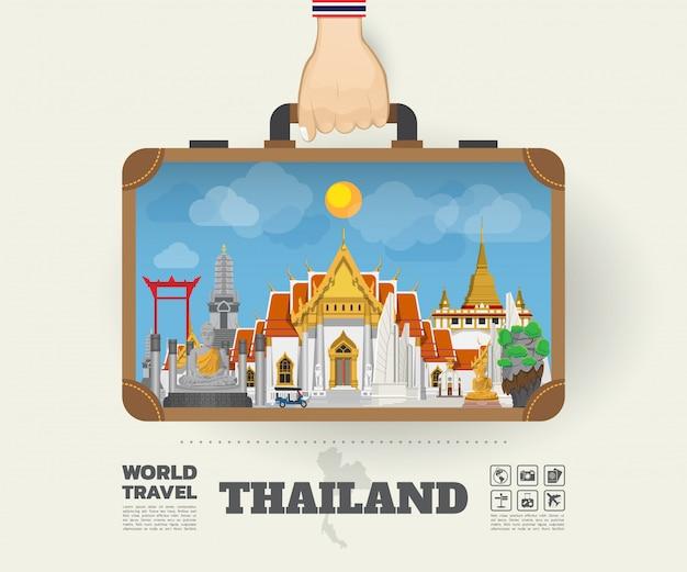Hand, die thailand-markstein-globale reise und reise infographic-tasche trägt. Premium Vektoren