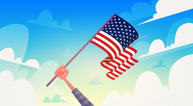 Hand, die usa-flagge über nationalem patriot-tag usa-feiertags-fahne des blauen himmels hält Premium Vektoren