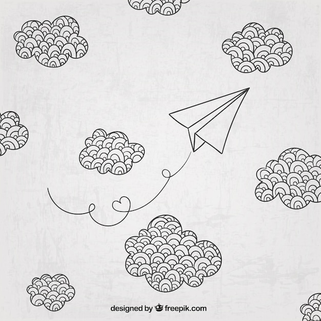 Hand gezeichnet papier flugzeug und wolken Kostenlosen Vektoren