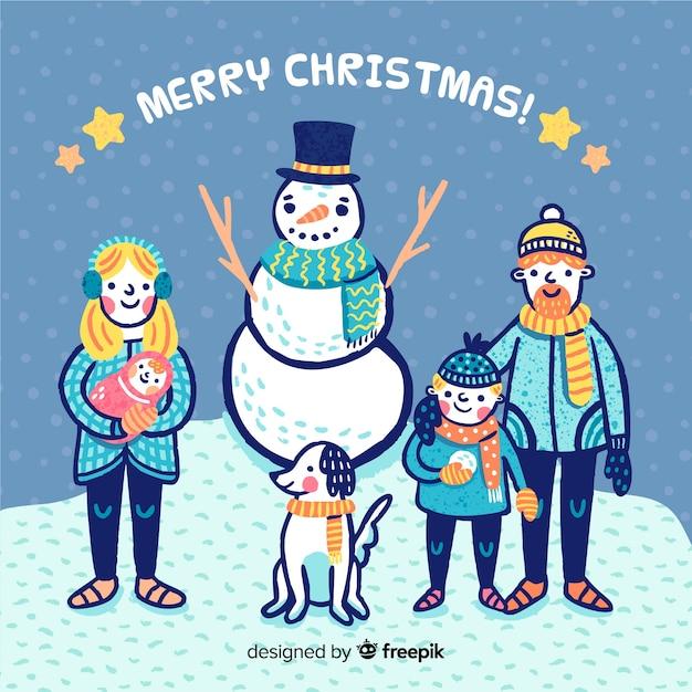 Hand gezeichnete familie mit schneemannweihnachtshintergrund Kostenlosen Vektoren