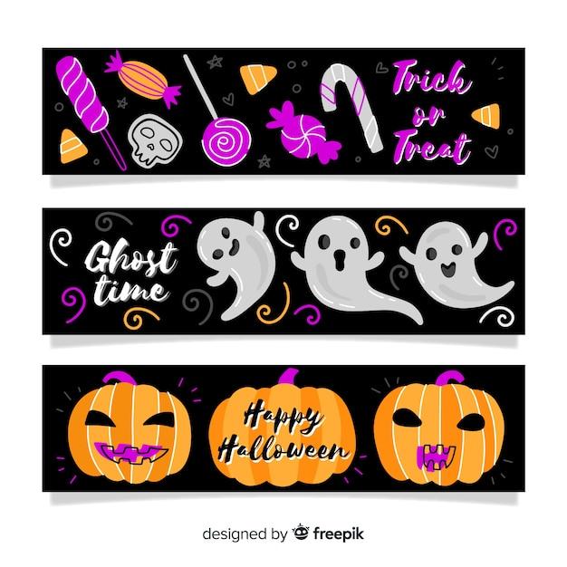 Hand gezeichnete halloween-fahnen mit kürbis und geist Kostenlosen Vektoren