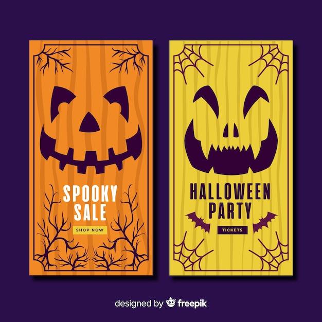 Hand gezeichnete halloween-fahnen mit kürbisen Kostenlosen Vektoren