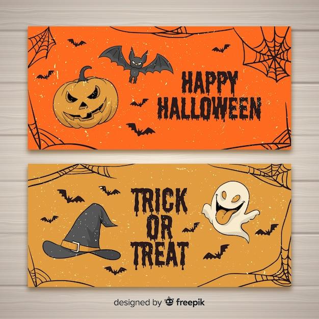 Hand gezeichnete halloween-fahnen Kostenlosen Vektoren