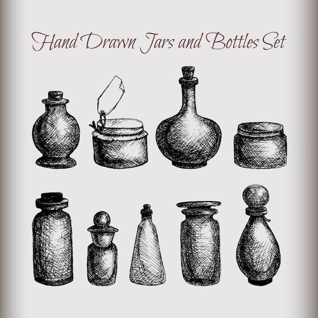 Hand gezeichnete lokalisierte weinlesegläser und -flaschen eingestellt Premium Vektoren