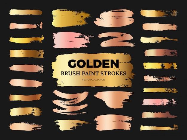 Hand gezeichnete schmutzrose und goldene bürstenfarbe streicht die sammlung, die auf schwarzem lokalisiert wird Premium Vektoren