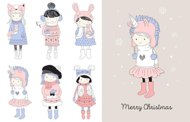 Hand gezeichnete schöne süße kleine wintermädchensammlung. frohe weihnachten grußkarten Premium Vektoren