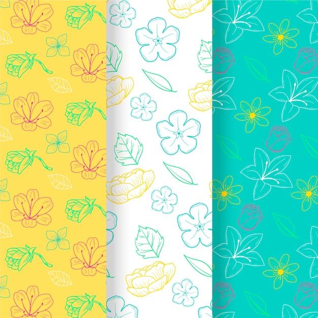 Hand gezeichneter frühlingsblumenmustersatz Kostenlosen Vektoren