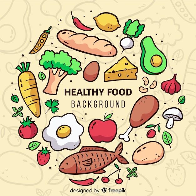 Hand gezeichneter gesunder lebensmittelhintergrund Kostenlosen Vektoren