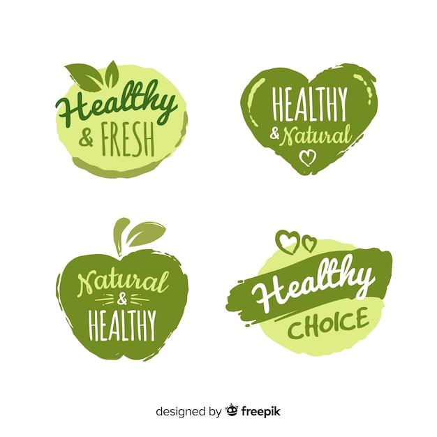 Hand gezeichneter gesunder lebensmittellogosatz Kostenlosen Vektoren