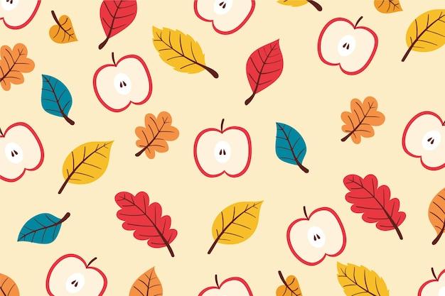 Hand gezeichneter herbsthintergrund mit blättern und äpfeln Kostenlosen Vektoren