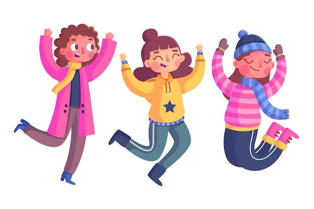 Hand gezeichneter springender satz der tragenden winterkleidung der jungen leute Kostenlosen Vektoren