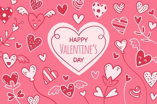 Hand gezeichneter valentinstaghintergrund Kostenlosen Vektoren