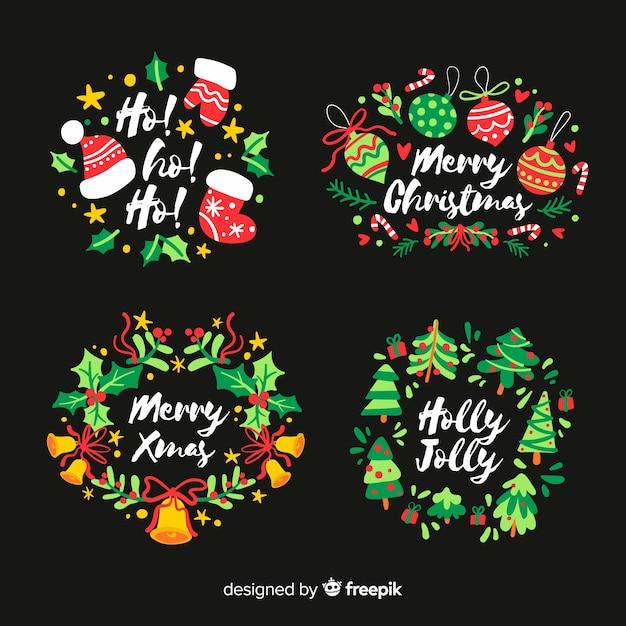 Hand gezeichneter weihnachtsaufkleber auf schwarzem hintergrund Kostenlosen Vektoren
