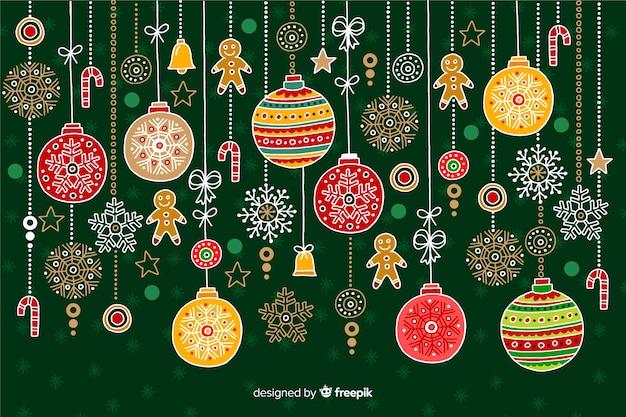 Hand gezeichneter weihnachtshintergrund mit dekoration Kostenlosen Vektoren