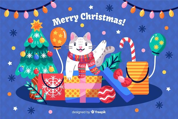 Hand gezeichneter weihnachtshintergrund mit katze und geschenken Kostenlosen Vektoren