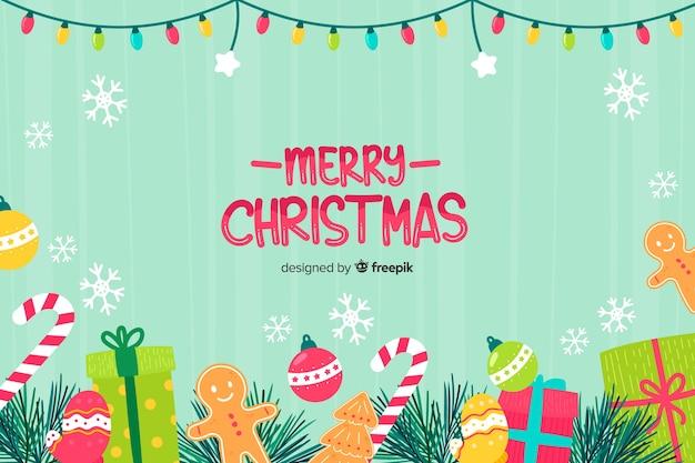Hand gezeichneter weihnachtshintergrund mit weihnachtselementen Kostenlosen Vektoren