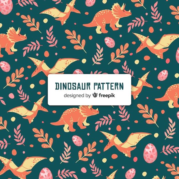 Hand gezeichnetes dinosauriermuster Kostenlosen Vektoren