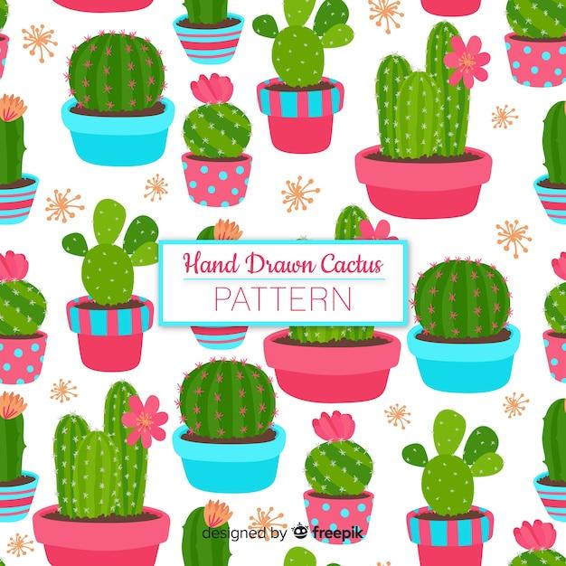 Hand gezeichnetes kaktusmuster Kostenlosen Vektoren