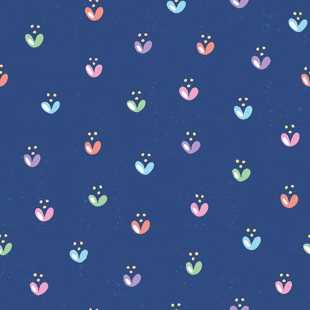 Hand gezeichnetes nahtloses muster mit niedlichen blumen. bunte blumenillustrationen mit textur auf tiefblauem hintergrund Premium Vektoren