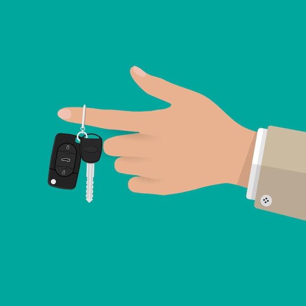 Hand hält autoschlüssel mit alarm und kette Premium Vektoren