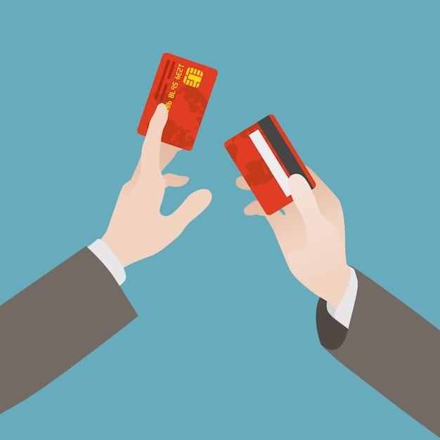 Hand hält die kreditkarte Premium Vektoren