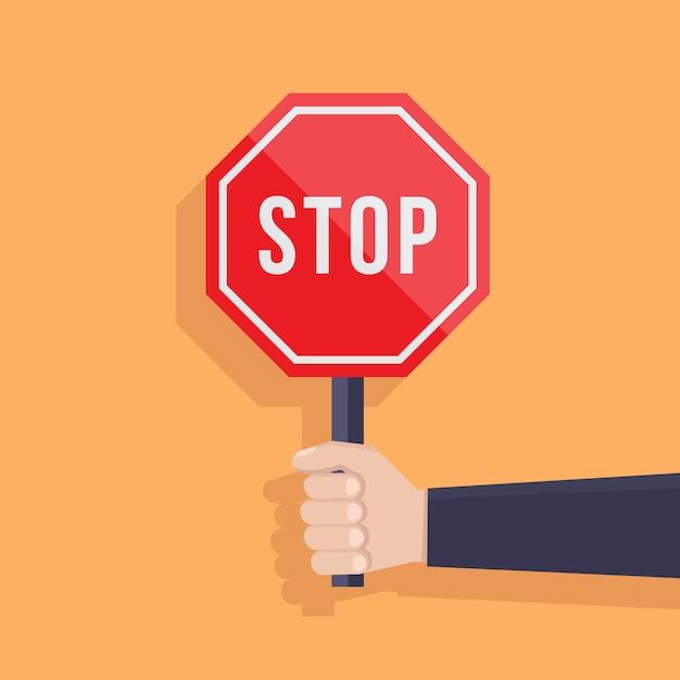 Hand hält flache designillustration des stoppschildes Premium Vektoren