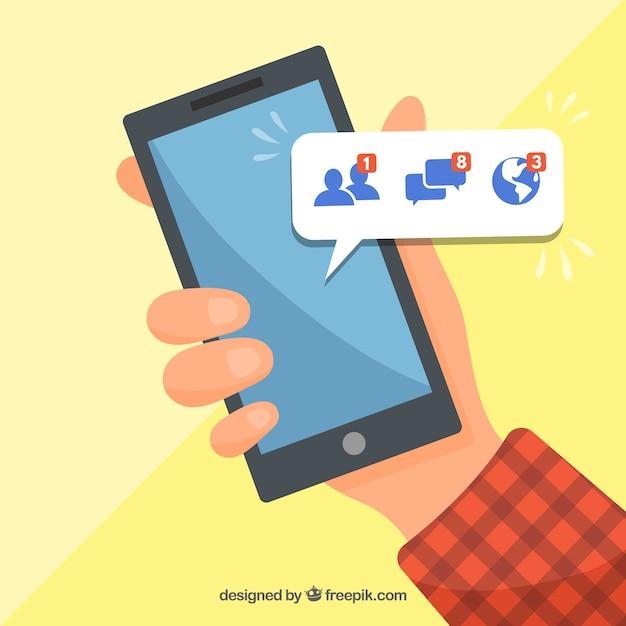 Hand hält telefon mit facebook-benachrichtigungen Kostenlosen Vektoren