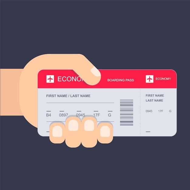 Hand mit flugticket Premium Vektoren
